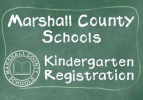 Green chalkboard with Marshall County Schools Kindergarten Registration written in white chalk